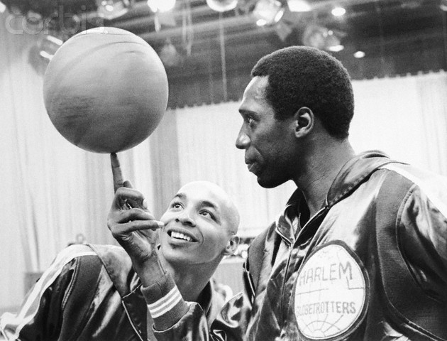 "March 1968 --- Basketball, Anyone? Fred ""Curly"" Neal (left) admires Meadowlark Lemon's adroit ball-handling in the CBS Sports special, , to be broadcast in color Saturday, January 24 (7:30-8:30 p.m., EST) on the CBS Television Network. March 1968. --- Image by © Bettmann/CORBIS"